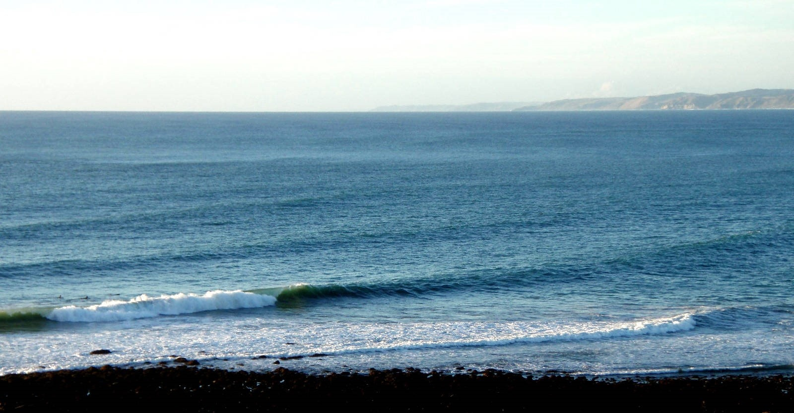 Surfing Raglan: Evening light at Manu Bay.