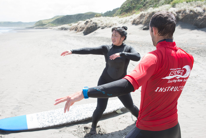 Learning technique on the surf course in raglan, New Zealand.