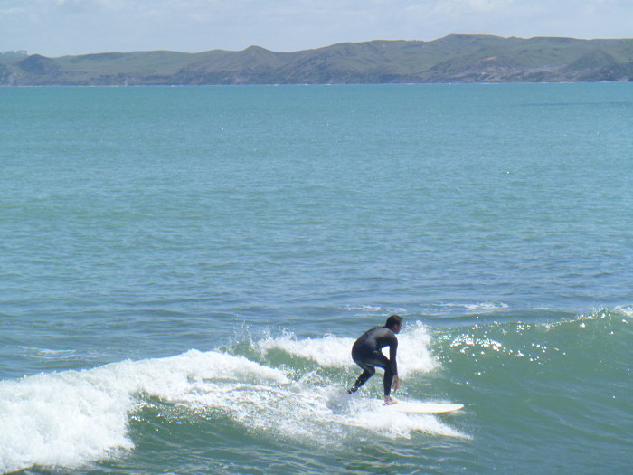 Learn to surf in Raglan.