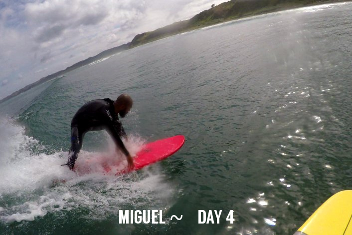 Learning to surf in New Zealand.